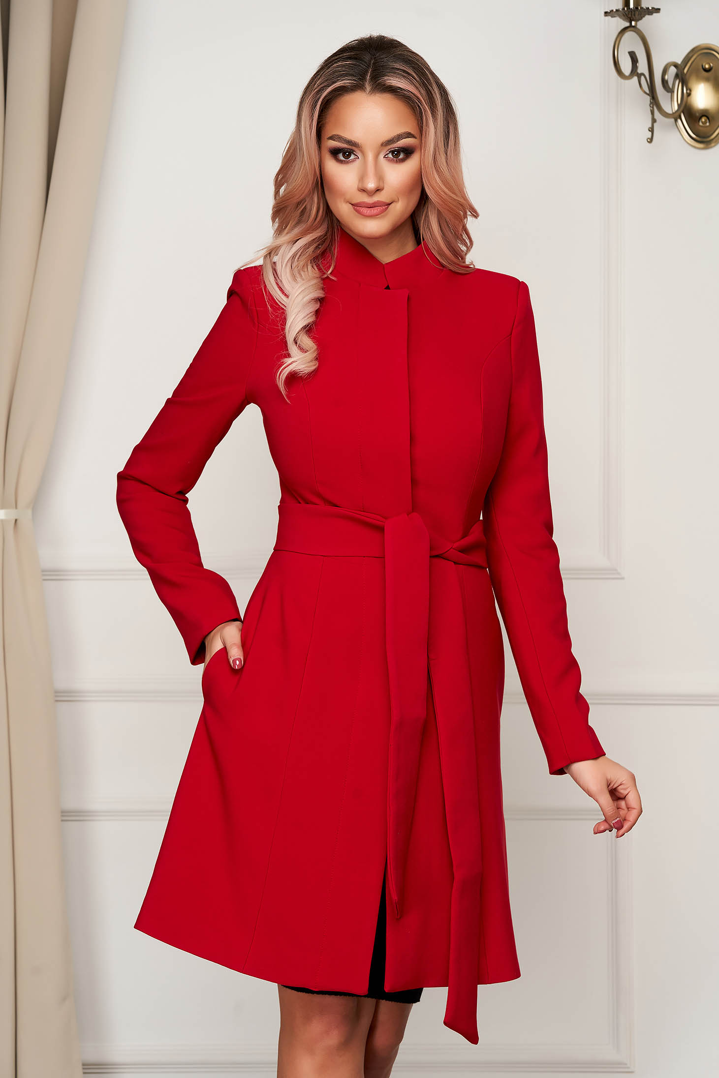 Cloche with inside lining accessorized with tied waistband elegant with bow red overcoat