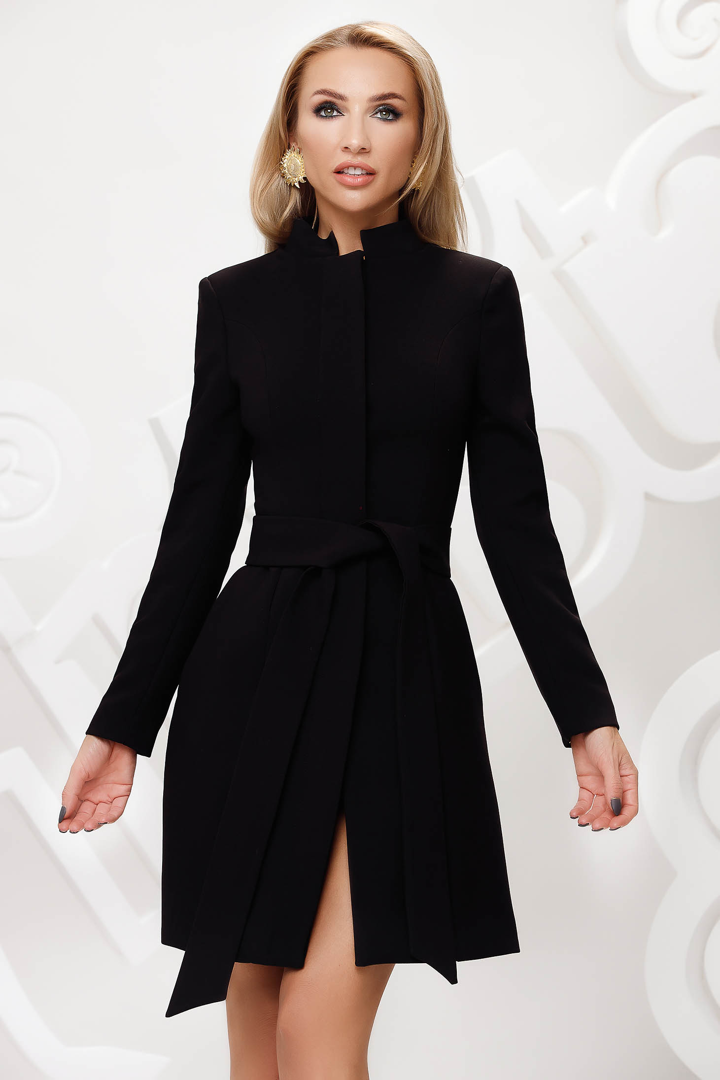 Cloche with inside lining accessorized with tied waistband elegant with bow black overcoat