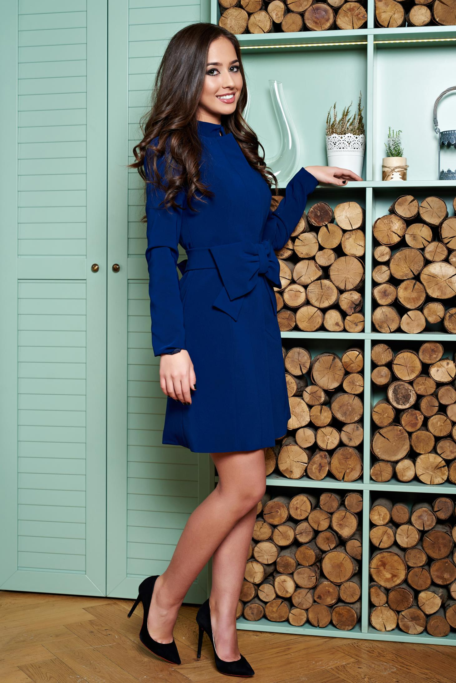 Artista blue elegant cloche coat with inside lining accessorized with tied waistband with bow