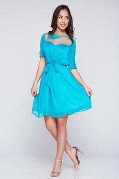 Artista turquoise voile fabric dress accessorized with tied waistband