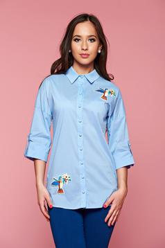 Asymmetrical cut PrettyGirl lightblue women`s shirt with embroidery details