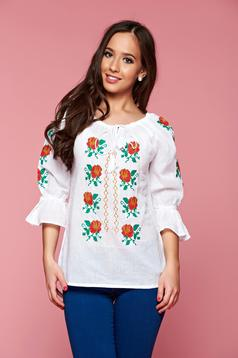 Embroidered white women`s blouse with bell sleeve
