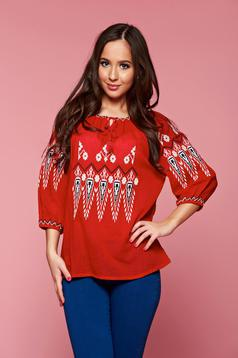 Embroidered red women`s blouse