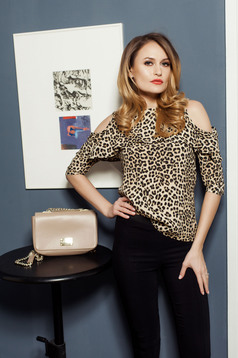 PrettyGirl cream women`s blouse with animal print and both shoulders cut out