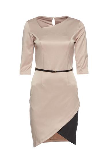 PrettyGirl cream asymmetrical dress accessorized with belt