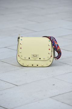Leather yellow bag with metallic spikes