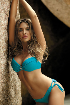 Turquoise swimsuit accessorized with breastpin push-up cups
