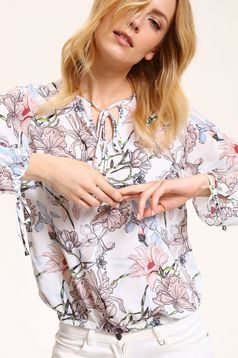 Top Secret easy cut white women`s blouse with floral prints from airy fabric