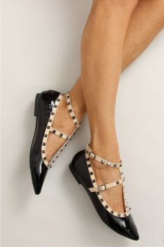 Black slightly pointed toe tip shoes with metallic spikes