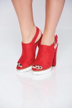 Red sandals with metallic buckle and high heel