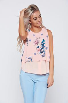 Peach voile fabric women`s blouse with floral prints