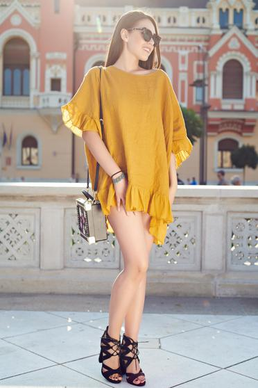 Yellow casual women`s blouse with easy cut from airy fabric