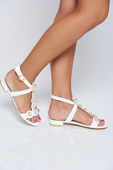 White elegant sandals with pearl embellished details