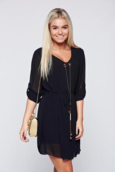 Black elegant easy cut dress with metalic accessory