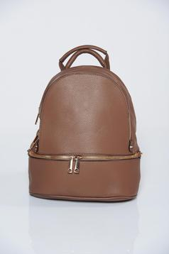 Brown backpacks with adjustable straps
