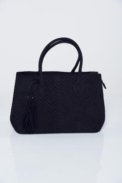 Black bag with tassels seams inside the fabric