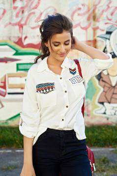 White flared women`s shirt embroidery details
