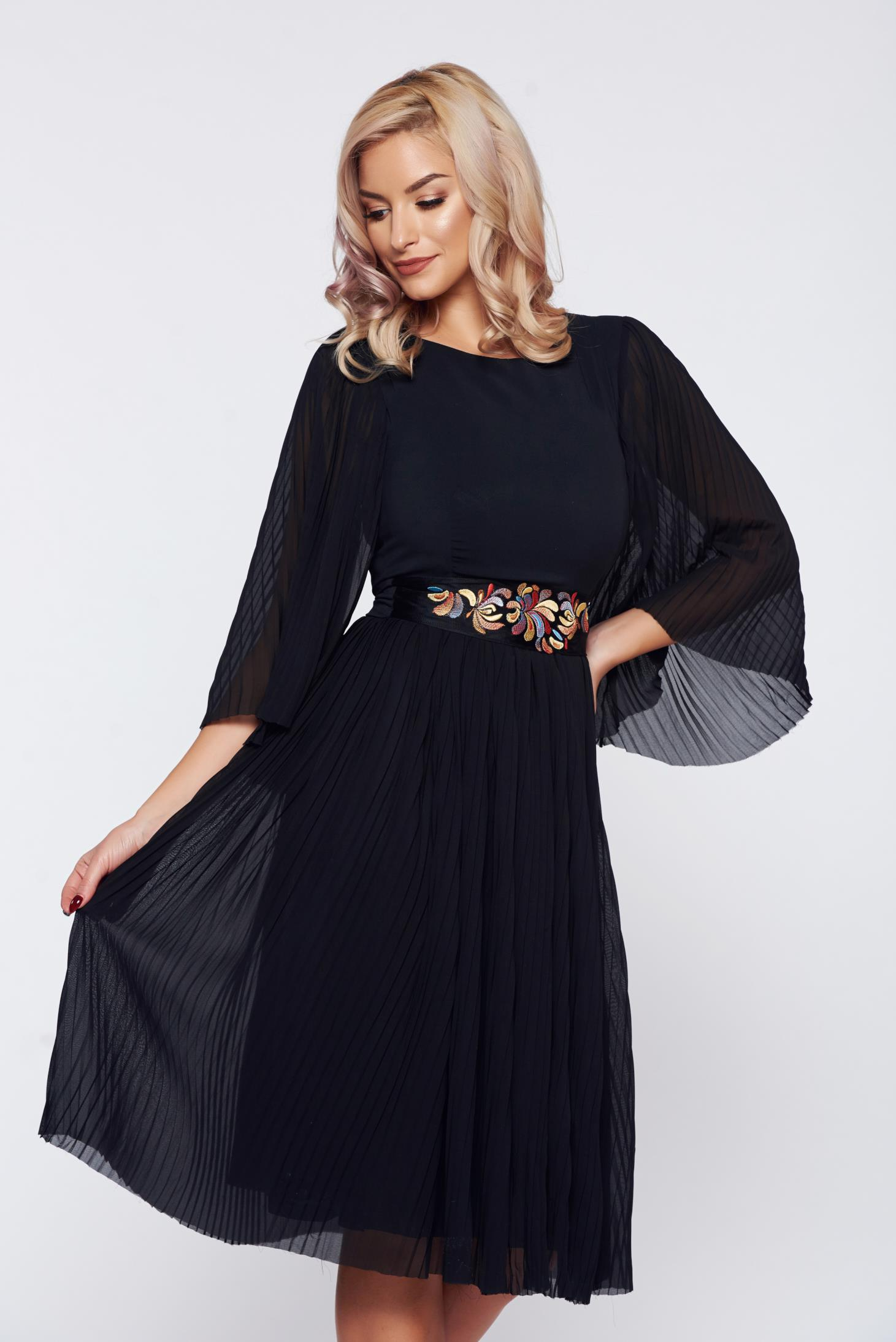 StarShinerS black occasional embroidered dress from veil fabric folded up accessorized with tied waistband