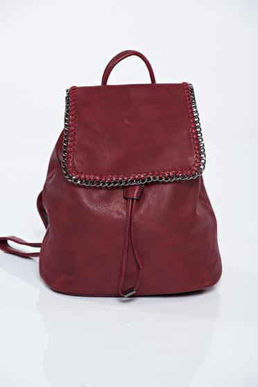 Burgundy ecological leather backpack accessorized with chain
