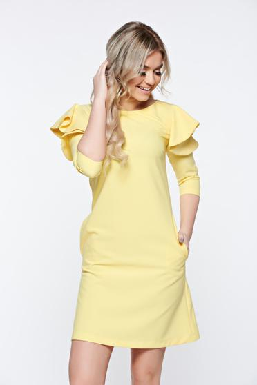 LaDonna with easy cut yellow dress with ruffled sleeves