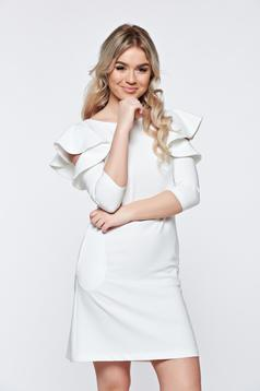 LaDonna with easy cut white dress with ruffled sleeves