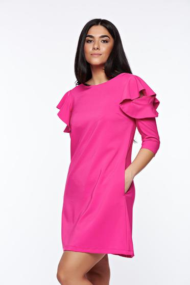 LaDonna with easy cut pink dress with ruffled sleeves