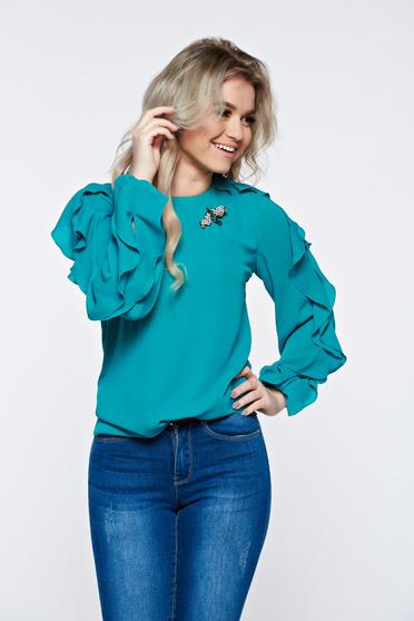 LaDonna turquoise women`s blouse elegant accessorized with breastpin airy fabric