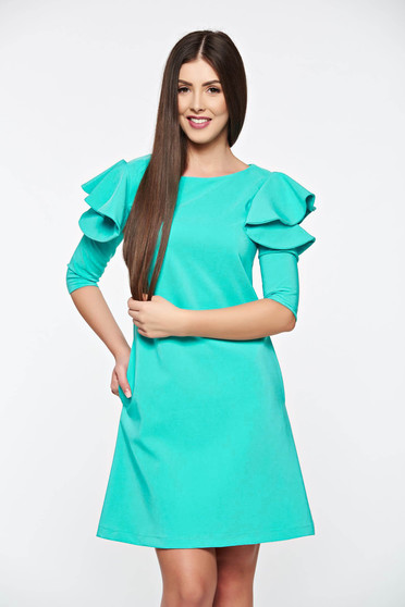 LaDonna with easy cut mint dress with ruffled sleeves
