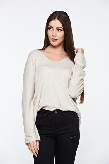 Cream women`s blouse knitted flared from soft fabric