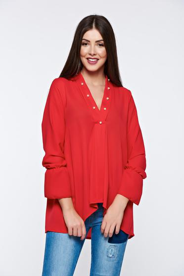 Red women`s blouse with easy cut asymmetrical with v-neckline with small beads embellished details