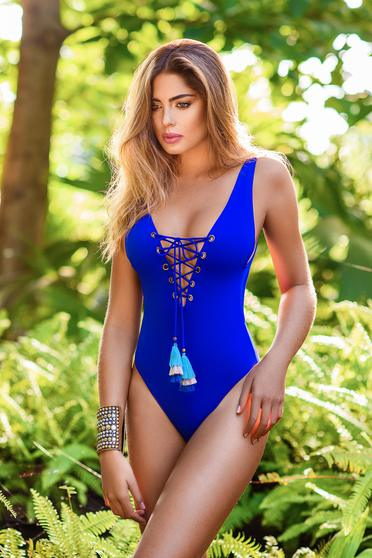 Cosita Linda blue altogether swimsuit from elastic and fine fabric with laced details with tassels