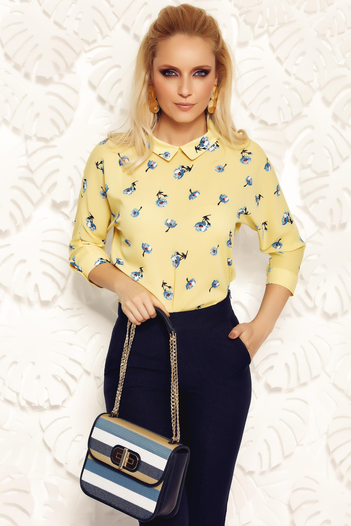 Fofy yellow elegant women`s blouse with easy cut airy fabric with pointed collar