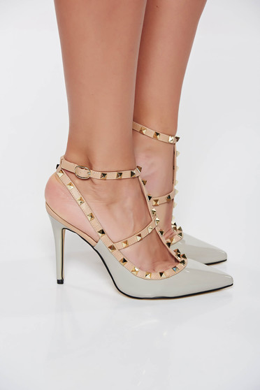 With high heels grey stiletto shoes with metallic spikes from ecological varnished leather