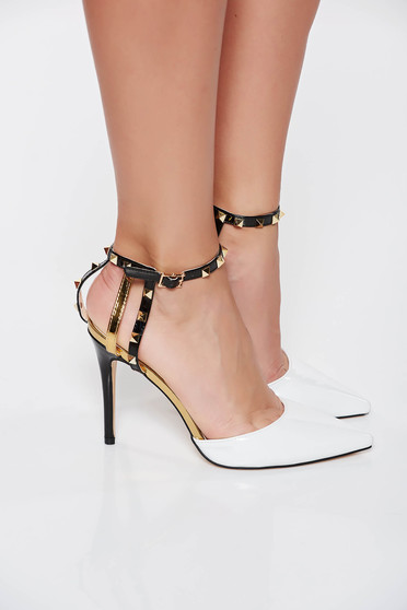 White elegant shoes with metallic spikes from ecological varnished leather