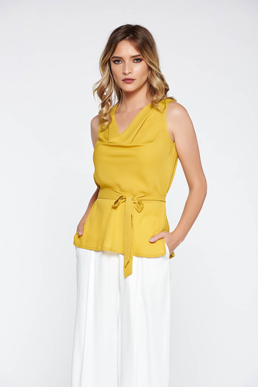 Yellow elegant flared women`s blouse airy fabric accessorized with tied waistband
