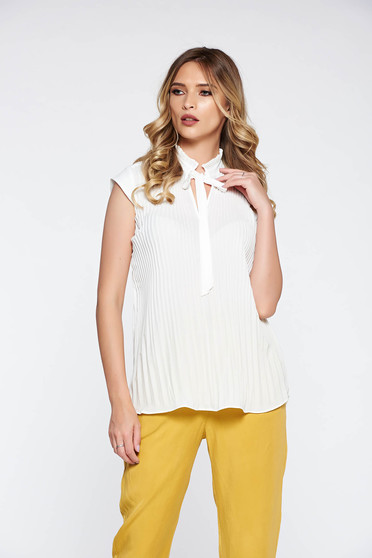 Elegant white women`s blouse folded up airy fabric flared