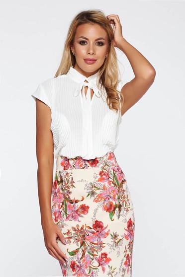 Elegant white women`s blouse folded up airy fabric flared