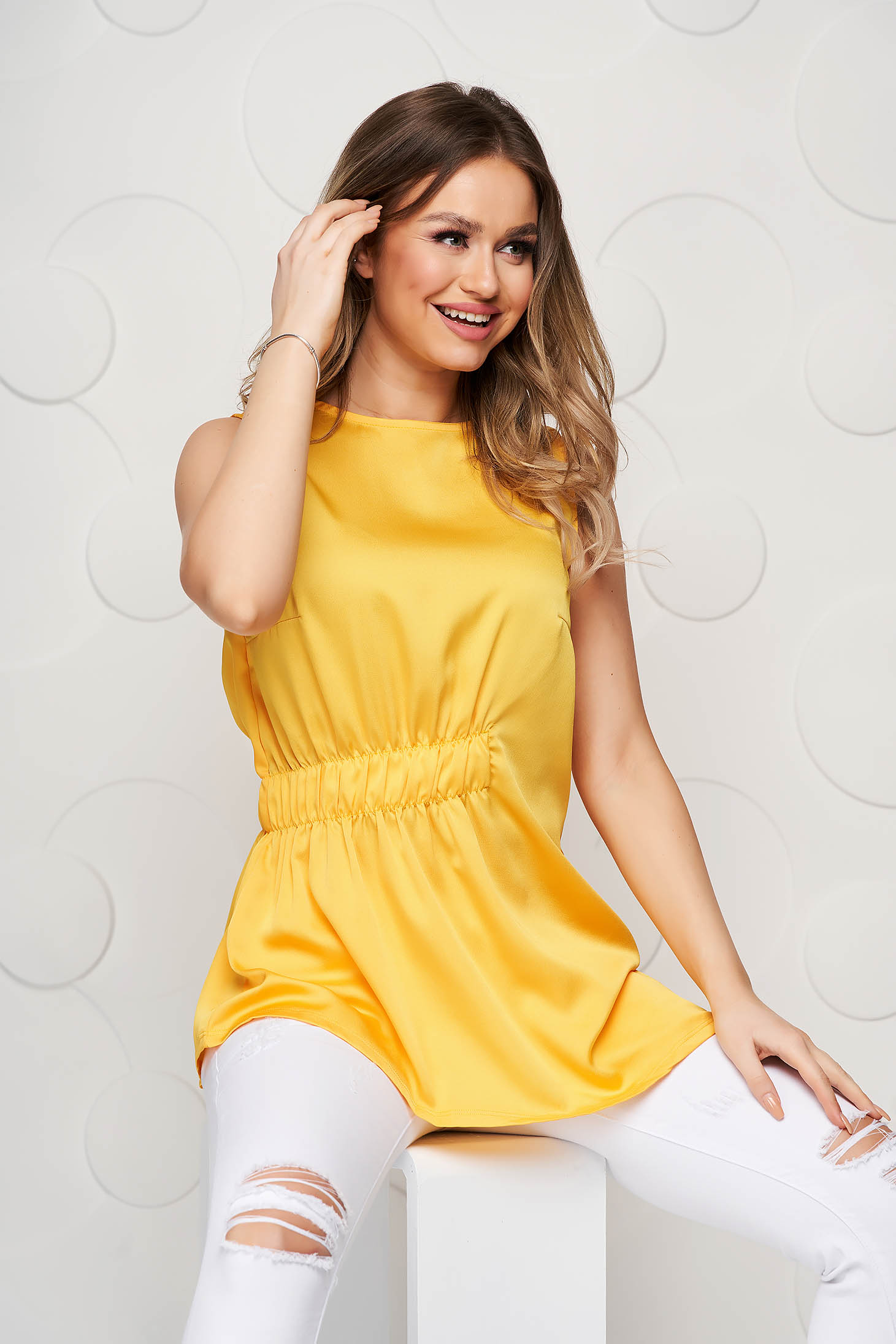 Top Secret yellow casual asymmetrical with easy cut women`s blouse with elastic waist from satin fabric texture