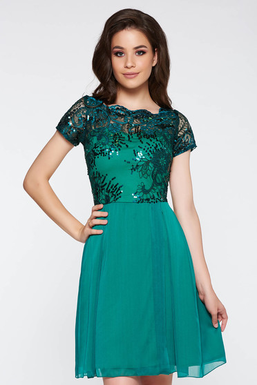 Green occasional cloche dress from laced fabric with sequin embellished details
