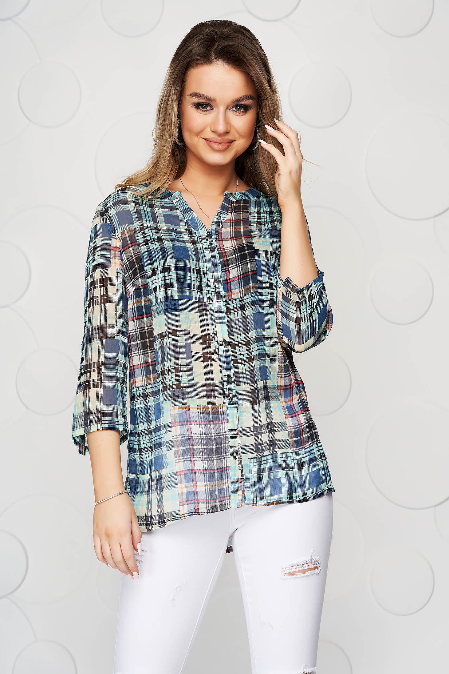 Blue women`s shirt with chequers thin fabric casual