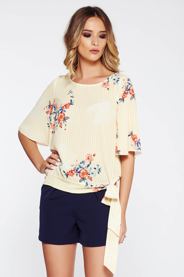 Yellow women`s blouse casual flared airy fabric with floral prints