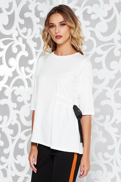 White casual flared women`s blouse slightly elastic fabric is fastened around the waist with a ribbon