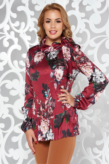 Burgundy elegant flared women`s blouse folded up from satin fabric texture