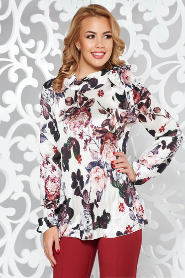 White elegant flared women`s blouse folded up from satin fabric texture