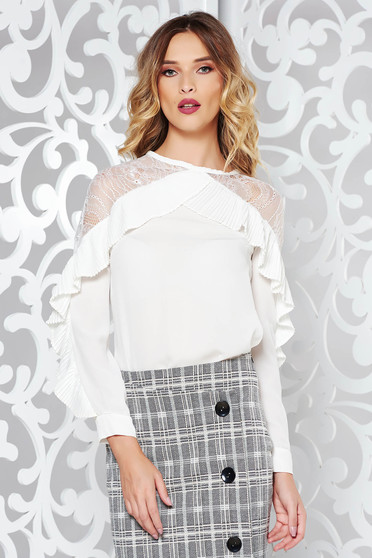White elegant flared women`s shirt with lace details with ruffle details slightly transparent fabric