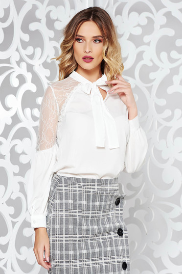 White elegant flared women`s shirt slightly transparent fabric with lace details