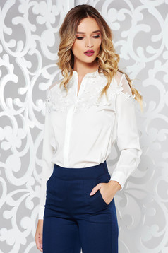 White elegant flared women`s shirt slightly transparent fabric with floral details
