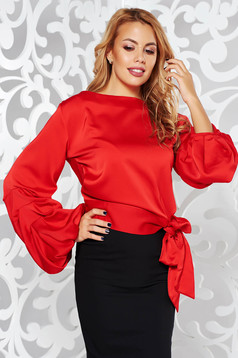Red elegant flared long sleeve women`s blouse from satin fabric texture