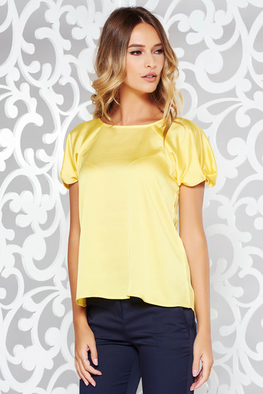Yellow women`s blouse elegant flared from satin fabric texture short sleeve