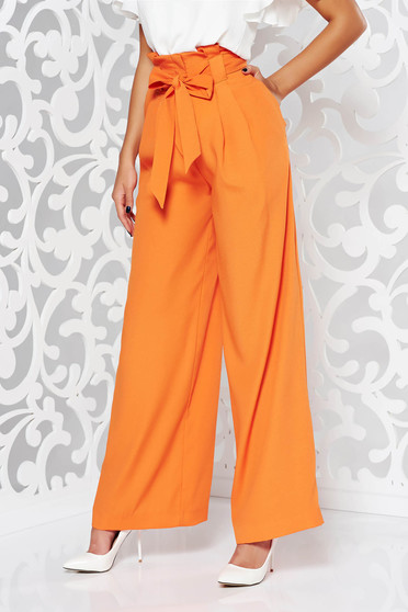 Orange elegant high waisted flared trousers slightly elastic fabric accessorized with tied waistband